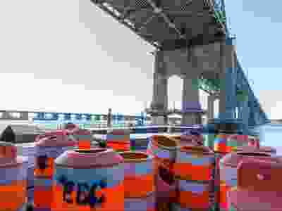 A view of construction cones and the underneath of the Champlain bridge undergoing repairs as seen towards the northern end in Montreal on Friday, September 4, 2015.