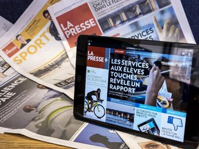 A tablet is seen on the paper edition of La Presse Wednesday, September 16, 2015 in Montreal.