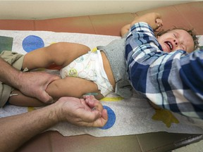 FILE - In this Jan. 29, 2015, file photo, pediatrician Dr. Charles Goodman vaccinates 1 year- old Cameron Fierro with the measles-mumps-rubella vaccine, or MMR vaccine at his practice in Northridge, Calif. California's Assembly on Thursday, June 25, 2015, approved a hotly contested bill requiring that nearly all public schoolchildren be vaccinated, clearing one of its last major legislative obstacles before the measure heads to the desk of Gov. Jerry Brown. The bill aims to increase immunization rates after a measles outbreak linked to Disneyland in December sickened over 100 people in the U.S. and Mexico.