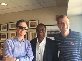 Former Expos player Warren Cromartie, now head of the Montreal Baseball Project (centre), poses with Boston Red Sox owner John Henry (left) and chief operating officer Sam Kennedy during trip to Boston on Sept. 7, 2015.