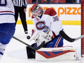 Montreal Canadiens goaltender Mike Condon makes a save during second period pre-season exhibition NHL hockey action against the Toronto Maple Leafs in Toronto on Saturday, September 26, 2015.