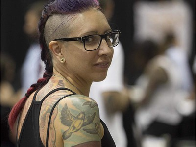 Josianne Labelle enjoys the art tattoo show held in Montreal on Friday September 11, 2015. The show at Place Bonaventure goes on through the weekend.