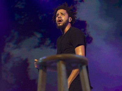 Hip-hop artist J. Cole looks out at the crowd at the Bell Centre in Montreal Friday, September 4, 2015 as he walks behind a stool. His most recent studio album is 2014 Forest Hills Drive.