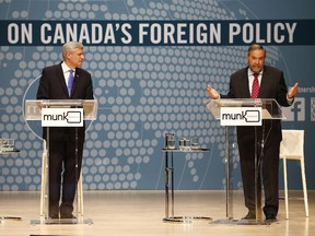 Conservative Leader Stephen Harper, left, and NDP Leader Tom Mulcair participate in the Munk Debate on Canada's foreign policy in Toronto, on Monday, Sept. 28, 2015.
