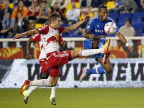Montreal Impact forward Didier Drogba, right, and New York Red Bulls defender Damien Perrinelle compete for the ball during the first half of an MLS soccer match Wednesday, Oct. 7, 2015, in Harrison, N.J.