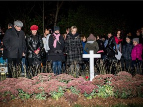 People gather at the vigil in Jenique Dalcourt's memory, on Wednesday October 21, 2015, in Longueuil. Jenique Dalcourt was beaten to death a year ago.