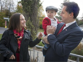 Liberal candidate Peter Schiefke holds his son Anderson as he waits with his wife Paula  Ruttel to vote in his riding of Vaudreuil-Soulanges, in Vaudreuil-sur-le-lac on Monday, October 19, 2015. (Peter McCabe / MONTREAL GAZETTE)