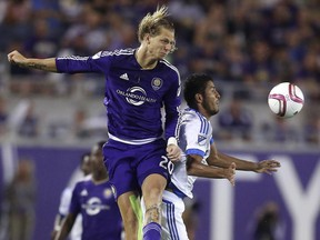 Orlando City's Brek Shea goes up for a header with Montreal Impact's Johan Venegas during their MLS soccer game at the Citrus Bowl in Orlando, Saturday, Oct. 3, 2015.