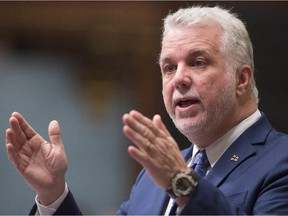 Quebec Premier Philippe Couillard responds to the Opposition during question period Wednesday, Oct. 21, 2015 at the legislature in Quebec City.