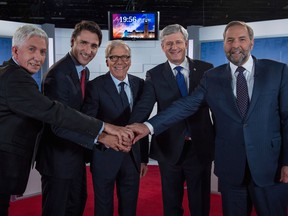 The Bloc Québécois' Gilles Duceppe (from left), Liberal Leader Justin Trudeau, moderator Pierre Bruneau, Conservative Prime Minister Stephen Harper and the NDP's Tom Mulcair smile for a pre-debate photo.