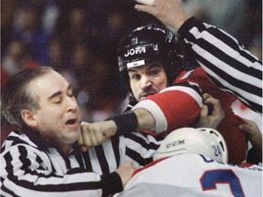 Devils' Mike Peluso bounces a punch off Habs' Lyle Odelein and nails linesmen Gérard Gautier on the chin.