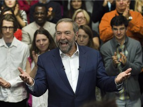 NDP Leader Tom Mulcair reacts to the applause as he arrives at a campaign stop in Montreal on Thursday, Oct. 1, 2015.