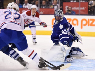 Toronto Maple Leafs goalie Jonathan Bernier makes a pad save on Montreal Canadiens' Dale Weise during first period season opener NHL action in Toronto on Wednesday, Oct. 7, 2015.