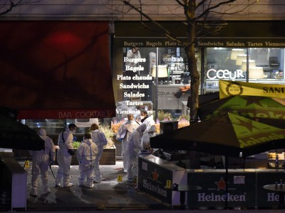 Forensic experts inspect the site of an attack, a restaurant outside the Stade de France stadium in Saint-Denis, north of Paris, early on November 14, 2015, after a series of gun attacks occurred across Paris as well as explosions outside the national stadium where France was hosting Germany. Dozens were killed and many injured in a series of gun attacks across Paris, as well as explosions outside the national stadium where France was hosting Germany.