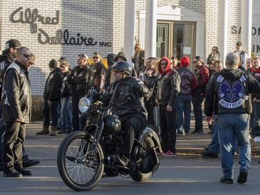 A motorcyclist leaves the Alfred Dallaire Funeral Home in Repentigny on Saturday, November 7, 2015.