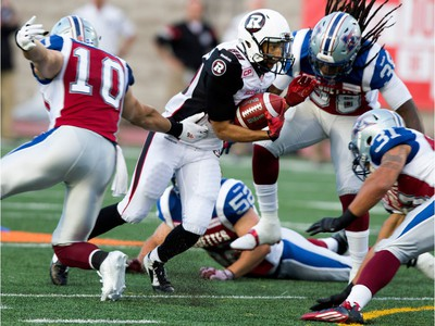 Ottawa Redblacks wide receiver Chris Williams is surround by Montreal Alouettes safety Marc-Olivier Brouillette, left to right, Montreal Alouettes linebacker Nicolas Boulay, Montreal Alouettes defensive back Dominique Ellis and Montreal Alouettes linebacker Winston Venable during CFL action at the Percival Molson Stadium in Montreal on Thursday June 25, 2015.