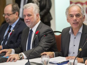 Quebec Premier Philippe Couillard and Ghyslain Picard, Regional Assembly of First Nations Chief of Quebec and Labrador, sit at the head of the table during a meeting with native leaders Wednesday, November 4, 2015 in Montreal.