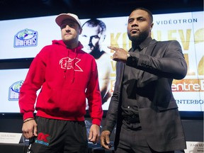 Light-heavyweight champion Sergey Kovalev from Russia, left, and challenger Jean Pascal of Laval pose for the cameras following a news conference in Montreal Monday, November 30, 2015, ahead of their title fight which takes place on January 30, 2016.