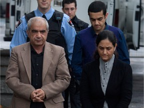 Mohammad Shafia, his son Hamed and Tooba Yahya walk into courthouse in Kingston, Ont., on Oct. 20, 2011.