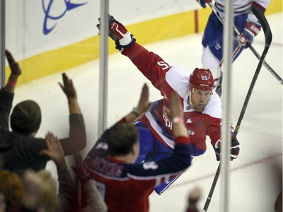 Washington Capitals left wing Jason Chimera (25) celebrates his goal against the Montreal Canadiens during the third period of an NHL hockey game, Saturday, Dec. 26, 2015, in Washington. The Capitals won 3-1.