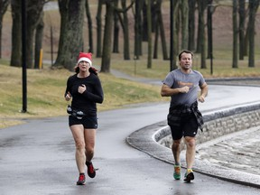 Danie Labonville and Yves Blanchard jog in Mount Royal Park in Montreal on Thursday December 24, 2015. Josh Freed urges Montrealers to seize the warm weather while it lasts.
