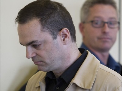 Guy Turcotte walks into a St-Jérôme courtroom where he was found guilty of two counts of second degree murder on Sunday.
