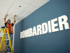 A worker repairs the ceiling in the main entrance of a Bombardier Aerospace plant in Queretaro, March 2, 2008. Photo/Chico Sanchez