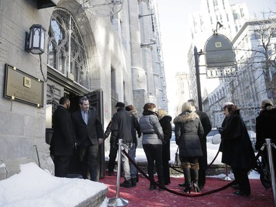 Mourners line up to pay their respects to René Angélil, pop star Céline Dion's husband and manager, Jan. 21, 2016, at Notre Dame Basilica in Montreal.