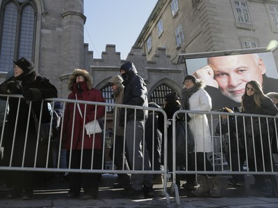 Mourners line up to pay their respects to René Angélil, pop star Céline Dion's husband and manager, Thursday January 21, 2016 at the Notre Dame Basilica in Montreal. Angélil died of cancer January 14, 2016 and was lying in state Thursday before his funeral Friday.