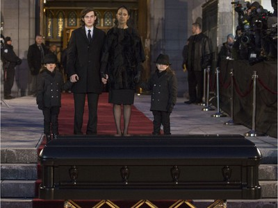 Céline Dion with her  sons  René-Charles, to her right and twins Nelson and Eddy stand before the casket after the funeral for husband and father,  René Angélil, at Notre Dame Basilica, in Montreal, Friday January 22, 2016.