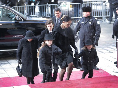 Singer Céline Dion walks with her twin sons, Nelson and Eddy, followed by her older son, René-Charles and her mother, far left, at the entrance of Montreal's Notre Dame Basilica on Friday January 22, 2016. René Angélil, leaves his wife Céline Dion, their three boys, and his three adult children from his first two marriages, Patrick, Jean-Pierre and Anne-Marie.