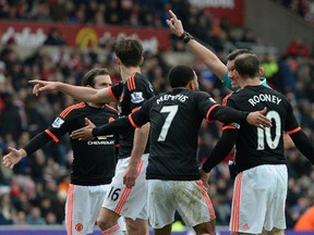 Manchester United's Dutch midfielder Memphis Depay (3R) and teammates call for a handball after Depay struck a shot towards goal during the English Premier League football match between Sunderland and Manchester United at the Stadium of Light in Sunderland, northeast England on Feb. 13, 2016.  Sunderland won the match 2-1.