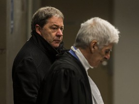 Daniel Gauthier, left, with his lawyer Jean-Claude Hébert, leaves the courtroom after pleading guilty at the Contrecoeur real-estate development corruption trial at the Palais de Justice in Montreal, on Friday, Feb. 12, 2016.