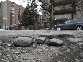 A pothole at the corner of Charlevoix and Lionel Groulx in Montreal photographed on Tuesday February 23, 2016.