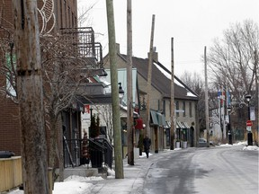 The main street in Ste-Anne-de-Bellevue village was closed to traffic most of the day on Thursday January 28 as Hydro crews took down the utility lines on the polls that line the south side of the street. (Marie-France Coallier / MONTREAL GAZETTE)