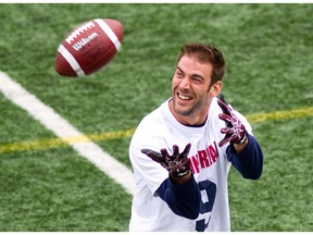 Montreal Alouettes' Eric Deslauriers prepares to catch a pass on the sidelines during a  practice at Hébert Stadium in St-Léonard on July 24, 2013.