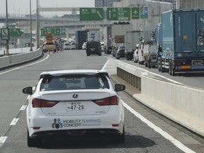 Toyota Motor Corp., automated driving test vehicle enters a highway on-ramp in Tokyo, Tuesday, Oct. 6, 2015.  Toyota unveiled its vision for self-driving cars in a challenge to other automakers as well as industry newcomer Google Inc., promising to start selling such vehicles in Japan by 2020.