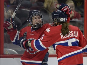 Les Canadiennes' Marie-Philip Poulin, left, celebrates with teammate Lauriane Rougeau at the Canadian Women's Hockey League final action at the Clarkson Cup on Sunday March 13, 2016, in Ottawa.