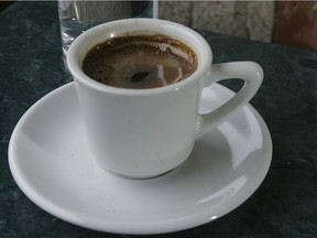 Traditional Greek coffee in a small cup.