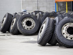 Tires ready to be installed on buses lie on the ground at the new STM Stinson Transport Centre on Friday, March 18, 2016, in Montreal, Quebec. The STM has been renovating its maintenance centres in the last few years. The Stinson Transport Centre has received several awards for its environmental friendliness.