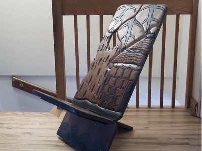 Folding wooden chair from Africa, in the apartment of Marie-Aline Vadius. (Pierre Obendrauf / MONTREAL GAZETTE)