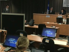 An unidentified engineer from the firm Roche testifies behind a screen to protect his identity at the Charbonneau Commission Thursday June 12, 2014 in Montreal.
