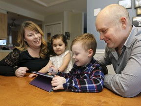 Amélie Dumont and Martin Maheux with their children Clara, 3 years old, and Timothy, 6, at their home in Laval, north of Montreal Thursday March 03, 2016. The family will see increased daycare fees next year. (John Mahoney / MONTREAL GAZETTE)