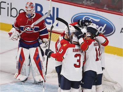 MONTREAL, QUE.: MARCH  15, 2016 -- Teammates of Florida Panthers' Aleksander Barkov, surround him after he score on Montreal Canadiens goalie Mike Condon, during third period NHL action in Montreal on Tuesday March 15, 2016. (Pierre Obendrauf / MONTREAL GAZETTE)