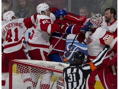 MONTREAL, QUE.: MARCH 29, 2016-- Detroit Red Wings goalie Jimmy Howard hits Montreal Canadiens right wing Mike Brown in the face with his blocker as Detroit Red Wings defenseman Danny DeKeyser tries to retrain Brown during NHL action at the Bell Centre in Montreal on Tuesday March 29, 2016. (Allen McInnis / MONTREAL GAZETTE)