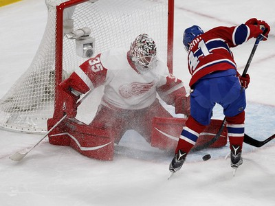 MONTREAL, QUE.: MARCH 29, 2016-- Detroit Red Wings goalie Jimmy Howard, left, stops Montreal Canadiens center Paul Byron during NHL action at the Bell Centre in Montreal on Tuesday March 29, 2016. (Allen McInnis / MONTREAL GAZETTE)