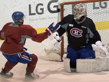 Centre Paul Byron tries recover to recover a rebound from Carey Price during a team practice at the Bell Sports Complex in Montreal on Monday, April 4, 2016.