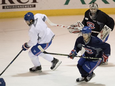 Left wing Max Pacioretty, left to right, leads Ryan Johnston  and goalie Charlie Lindgren during a team practice at the Bell Sports Complex in Montreal on Monday, April 4, 2016.