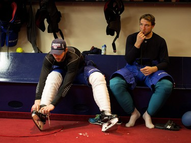 Alex Galchenyuk, left, and Stefan Matteau remove their gear in the locker room after a team practice at the Bell Sports Complex in Montreal on Monday, April 4, 2016.