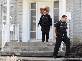 Police officers leave a house where convicted killer Karla Homolka lives, according to some media reports, in Chateauguay, Que., Wednesday, April 20, 2016.Reports that Homolka has resurfaced southwest of Montreal are creating a buzz in the town of Chateauguay.